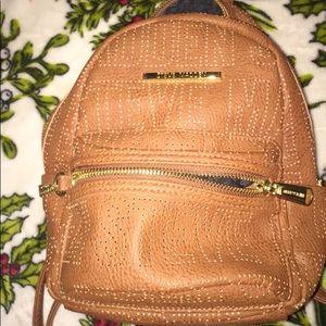 A Steve Madden mini backpack